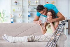 The husband man supporting injured wife. Husband men supporting injured wife Royalty Free Stock Photography