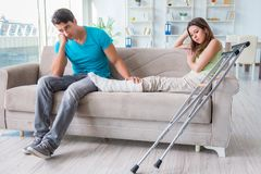 The husband man supporting injured wife. Husband men supporting injured wife Stock Image