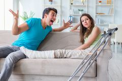 The husband man supporting injured wife. Husband men supporting injured wife Stock Photos