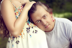 Husband middle age listening to stomach of pregnant wife and loo Royalty Free Stock Image