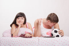Husband not upset by goal scored, wife was tired football Stock Image