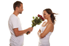Husband offering a rose to happy wife Stock Photo