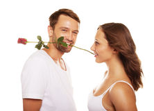 Husband offering a rose to happy wife Royalty Free Stock Photography