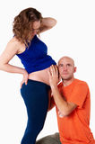 The husband overhears in the belly of his wife Royalty Free Stock Photo