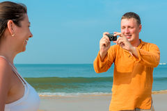 Husband photographing his wife Stock Photos