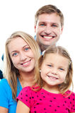 Husband posing with his adorable wife and daughter Royalty Free Stock Photo