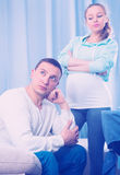 Husband and pregnant wife arguing at home Stock Photography