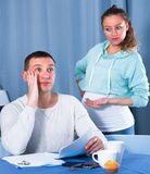 Husband and pregnant wife arguing at home Royalty Free Stock Photography
