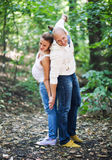 Husband and pregnant wife back to back Stock Images