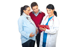 Husband and pregnant wife at doctor stock photos