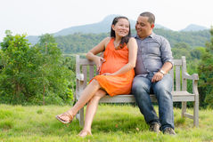 Husband with pregnant wife is resting in nature. Royalty Free Stock Photo