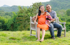 Husband with pregnant wife is resting in nature. Stock Images