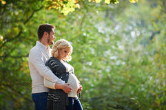 Husband and pregnant wife are walking in the park Royalty Free Stock Photography
