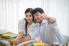 Husband with Pregnant woman having breakfast in dining room Stock Image