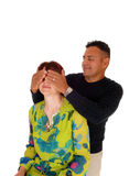 Husband putting his hands over the wife's eye's. Royalty Free Stock Image