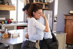 Husband Saying Goodbye To Wife As He Leaves For Work Royalty Free Stock Photography