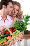 Husband showing wife vegetables Stock Images