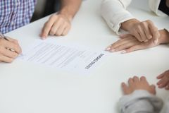 Husband signing divorce decree giving permission to marriage dis. Husband signing uncontested divorce decree paper giving permission to break up, unhappy couple stock images