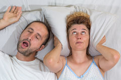 Husband snoring. Sleep and leaves his wife stock photos