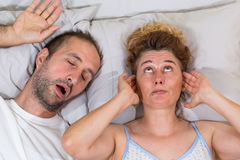 Husband snoring. Sleep and leaves his wife Stock Image