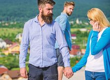 Husband strictly watching his wife looking at another guy while walk. Jealous concept. Man with beard jealous aggressive royalty free stock image