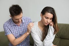 Husband supporting comforting upset depressed wife, infertility stock photos