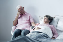 Husband supporting mortally ill wife Royalty Free Stock Photo