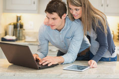 Husband surfing internet while wife is looking on Royalty Free Stock Photos