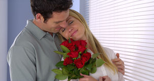 Husband surprises his wife with flowers Royalty Free Stock Image