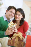 Husband Surprising Wife With Christmas Present Royalty Free Stock Images