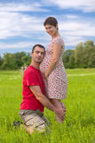 Husband taking care of his pregnant wife Stock Photo