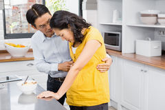 Husband taking care of his suffering pregnant wife Royalty Free Stock Photos