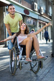 Husband taking spouse on wheelchair Stock Photos