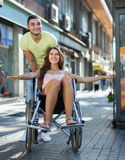 Husband taking spouse on wheelchair Royalty Free Stock Images