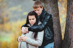Husband tender hugs his pregnant wife Stock Photography