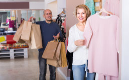 Husband tired awaiting woman shopping Stock Images