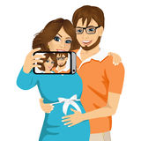Husband touching the belly of his pregnant wife Royalty Free Stock Photos