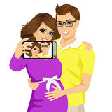 Husband touching the belly of his pregnant wife Stock Image