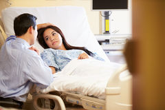 Husband Visiting Wife In Hospital Royalty Free Stock Image