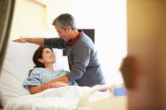 Husband Visiting Wife In Hospital Stock Images