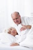 Husband waking up her wife. At the morning Stock Photos