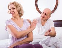 Husband warmly comforting upset wife   in bedroom Royalty Free Stock Photo