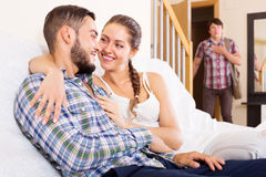 Husband watching how partner is cheating. On at home Royalty Free Stock Photos