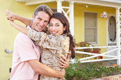 Husband Welcoming Wife Home On Army Leave. Hugging Royalty Free Stock Images