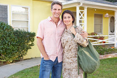 Husband Welcoming Wife Home On Army Leave. Smiling Stock Photos