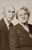 Husband and Wife. 1940s portrait of elderly man and woman.  Sepia-toned desaturated color file.  Original photograph taken in 1940s Stock Image