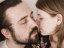 Husband and wife. Tenderly kiss royalty free stock image