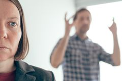 Husband and wife arguing, man yelling at woman stock photography