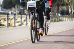 The husband and wife while biking Royalty Free Stock Photos