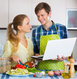 Husband and wife browsing internet Royalty Free Stock Photography